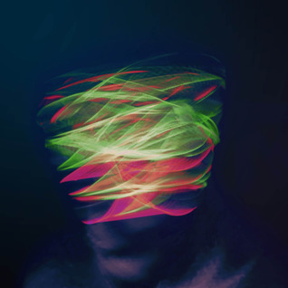 Nicholas Topping - Using UV string wrapped around an individuals head and a slow shutter priority, in order to capture the movement made whilst distracted.